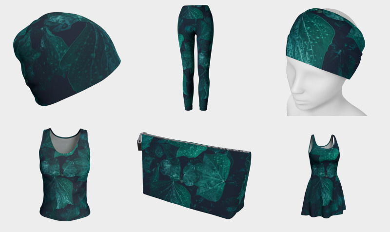 Dark emerald green ivy leaves water drops preview