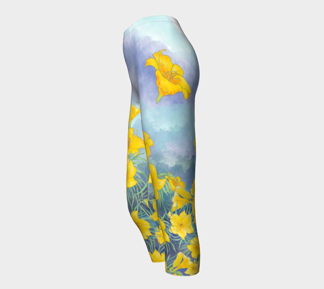 Yellow day lily flowers over cloudy sky capris preview #3
