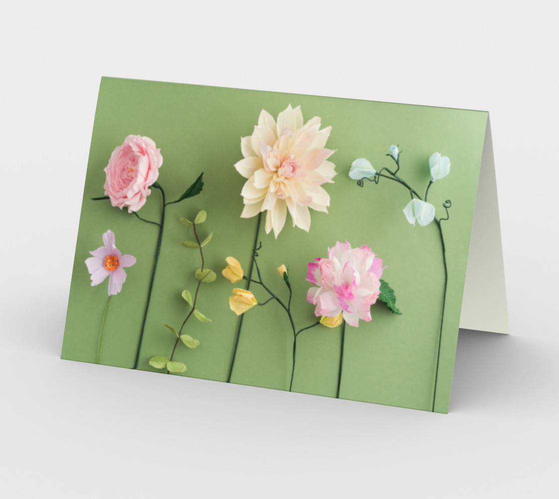 Crepe paper flowers on green preview #2