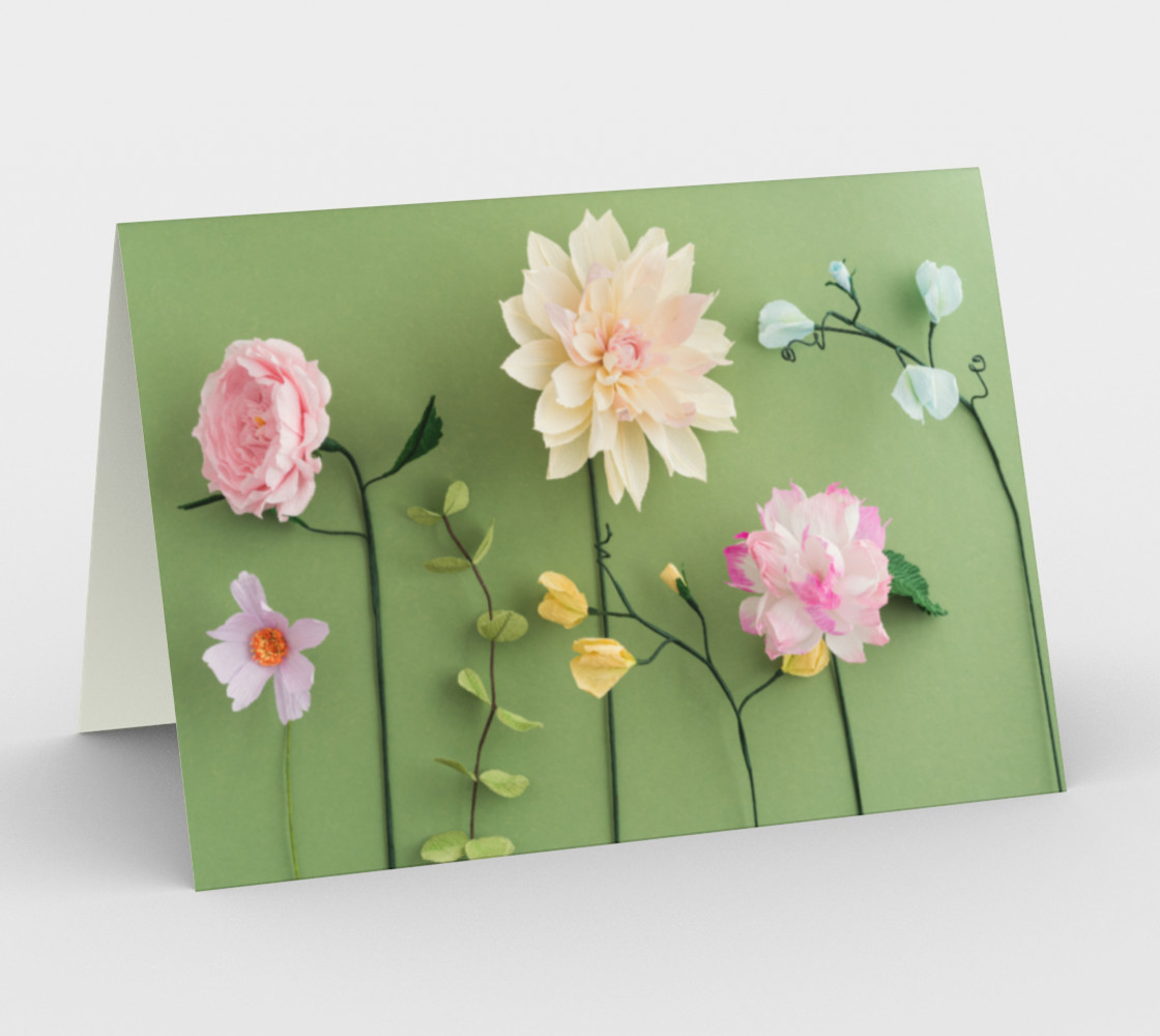 Crepe paper flowers on green preview #1