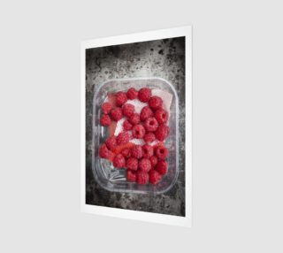 Raspberries in plastic container on old metal baking tray preview