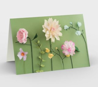 Crepe paper flowers on green preview
