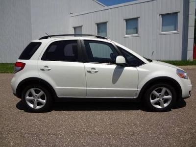 Photo AWD Manual 2.0L CD Aluminum Wheels 4-Wheel ABS AC