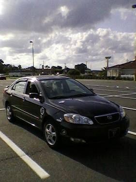 Photo 2007 Toyota Corolla CE - Black - 5 Spd Manual 35K Mi.