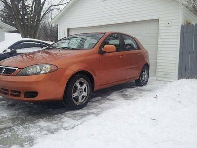 Photo 2006 Suzuki Reno Premium Hatchback 5-Door 2.0L