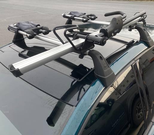 Photo Thule sidearm 594XT roof bike rack - $100 (Bethlehem)