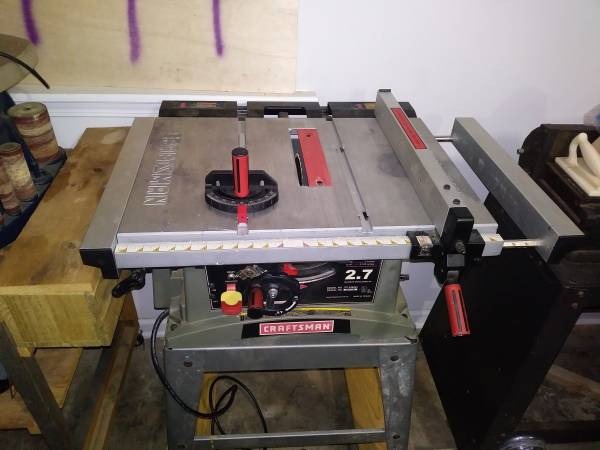 Photo Craftsman Table saw on rolling casters - $300 (Danielsville)