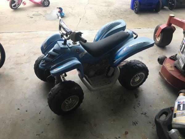 Photo Kids battery powered 4 wheeler (Fayetteville)