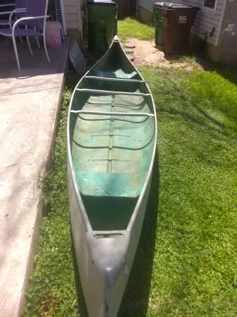 Photo Old school Quapaw 16 ft fiberglass canoe - $350 (Round Rock)