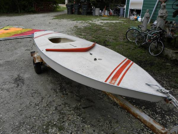 Photo Vintage Sunfish Sailboat with sail. Includes trailer. Ready to sail. - $1,200 (Volente)