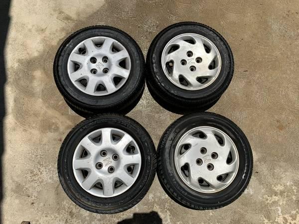 Photo 96-00 Honda Civic Wheels - OEM stock rims and tires - $75 (Bakersfield)