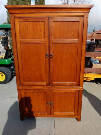 Photo Beautiful oak mission style entertainment armoire - $100