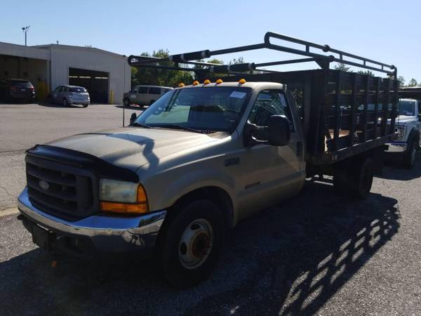 Photo 2000 FORD F350 FLATBED STAKE BED WITH 7.3 TURBO DIESEL LOW MILES - $3,900 (ELKRIDGE)