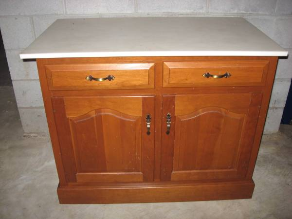Photo SOLID CHERRY CABINET WITH WHITE CORIAN TOP-VERY NICE - $500 (LUTHERVILLE)