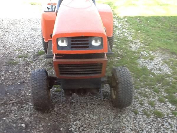Photo Ariens Garden Tractor 42quot mower deck and Roto tiller - $300 (Bellevue)