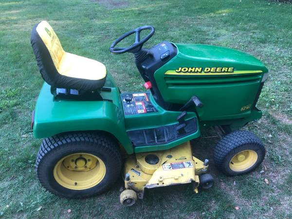 Photo John Deere 325 Garden Tractor  Riding Lawn Mower WITH 48quot DECK - $1,200 (Jackson)