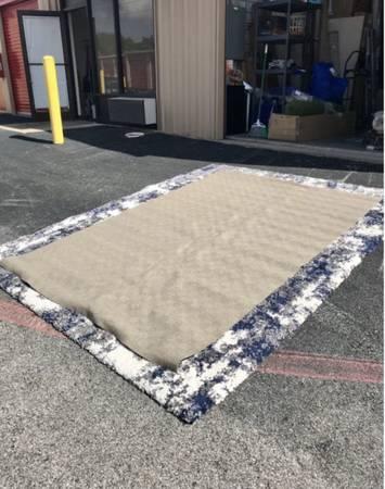 Photo Thin brown checker board texture pattern area rug carpet 3211 - $65 (Houston)