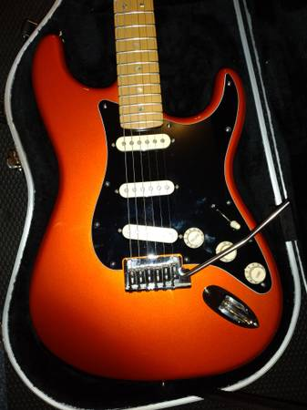 Photo Rare American Deluxe stratocaster in candy tangerine - $1100