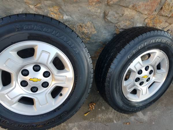Photo Set of 4 Silverado  GMC factory OEM rims and tires-17 inch - $275 (El Paso)