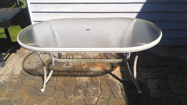 Photo Metal patio table with glass top - $20 (Boone)