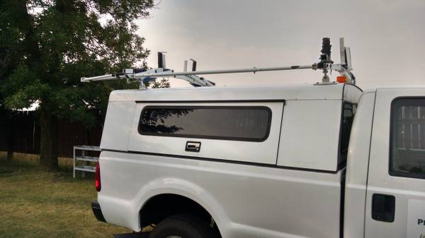 Photo Utility Truck Topper with Drop down Ladder Rack - $1,000 (Bozeman)