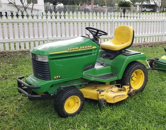 Photo John Deere 325 lawn tractor - $2,600 (Lyford)