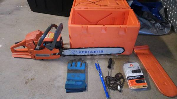 Photo Husqvarna chainsaw with case - $390 (West Valley)