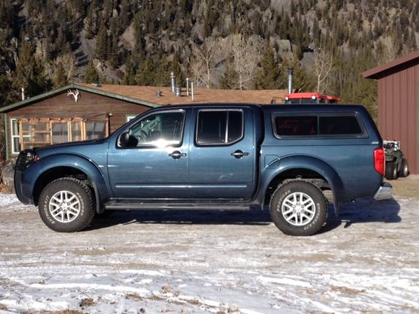 Photo 2015 Nissan Frontier SV 4x4 Extended Cap Lifted wExtras 95K - $19,500 (Anaconda)