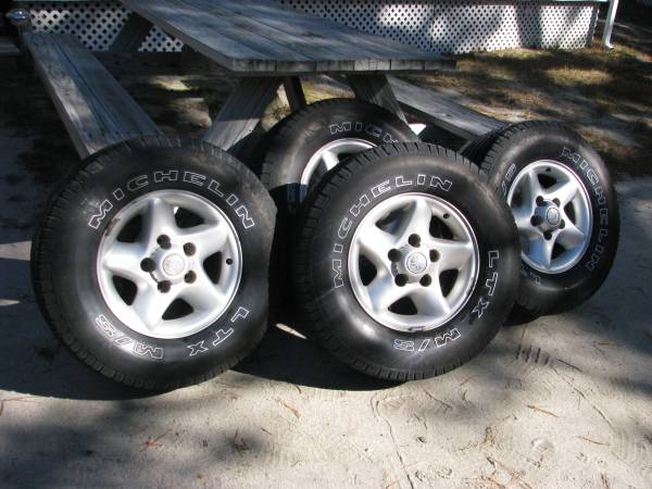 Photo 4 tires with rim for dodge ram - $150 (Wellfleet)