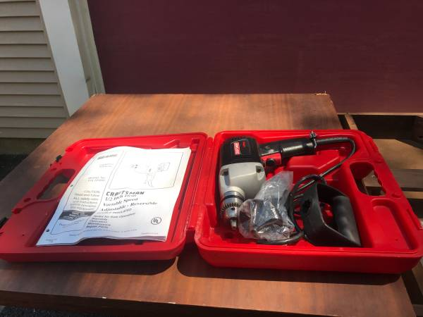 Photo Craftsman 12  variable and reversible electric drill - $38