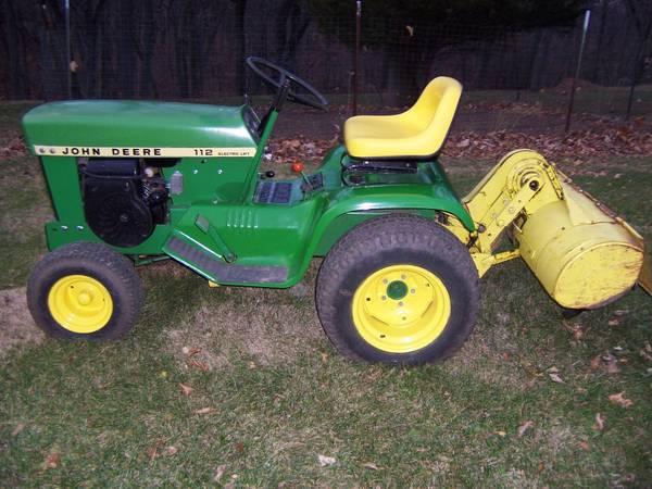 Photo John Deere garden tractor with tiller attachment - $900 (Iowa City)