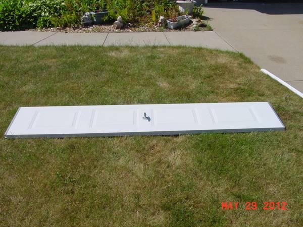 Photo Two panels for white 9x7 steel garage door - $30 (NE Cedar Rapids)