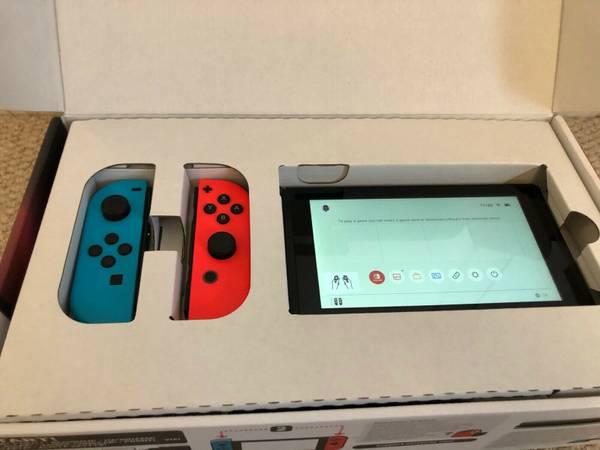 Photo Nintendo Switch Handheld Console - Neon BlueRed Joy-Con - $250 (central LA)