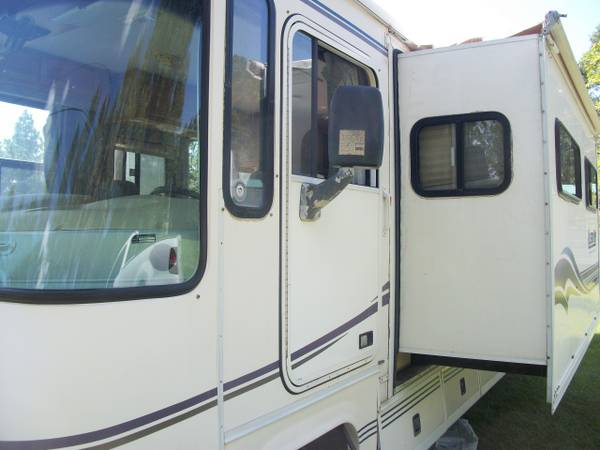 Photo 1998 Allegro Bay Class A Coach with Super Slide. 50 Amp RV. Chevy 454 - $12,950 (Palm Coast)