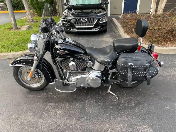 Photo 2011 Harley Davidson Softail Heritage 5,400 miles - $7,000 (Lake Baldwin)