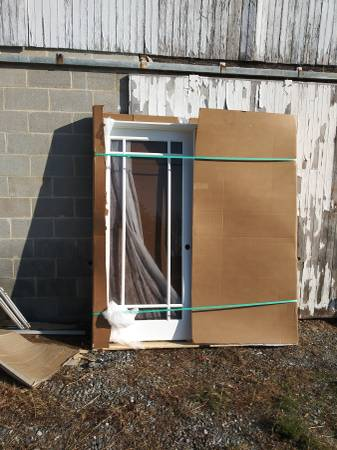 Photo Custom ordered hi end double open french doors half price - $1,000 (Newberry)