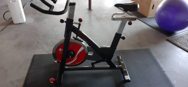 Photo Sunny Health  Fitness spin bike with power meter pedals - $700