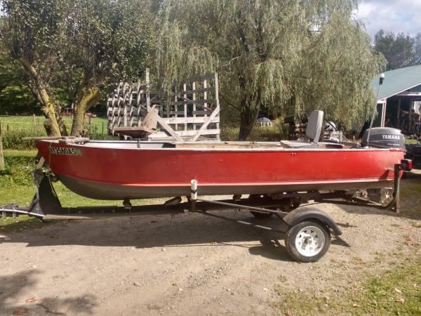 Photo 14 ft boat motor and trailer - $2000 (Dayton)