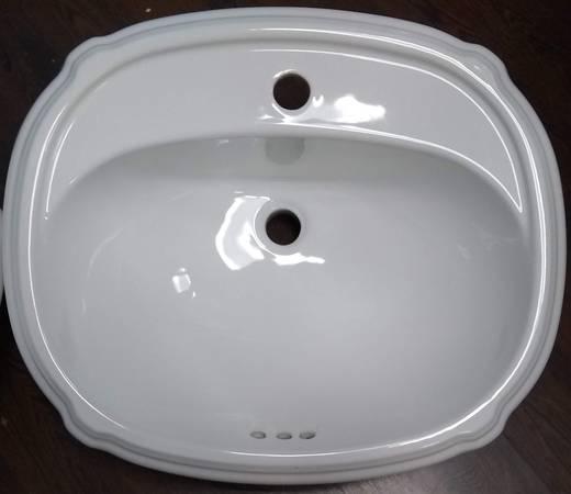 Photo (2) kohler Portrait Drop-in bathroom sink with single faucet hole - $250 (Buffalo)