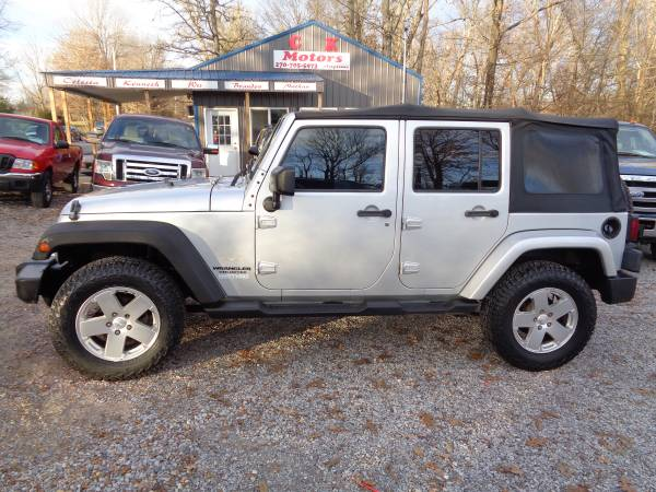 Photo 2010 Jeep Wrangler Unlimited ( 6 Speed ) Sahara  NEW TIRES - $10400 (Hickory  www.ckmotorsky.com)