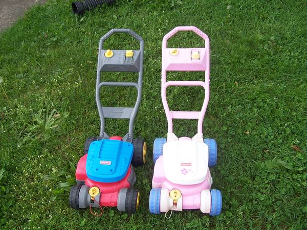 Photo 2 Little Tikes plastic bubble push lawnmowers 1 blue and red, 1 pink - $28 (Painesville)