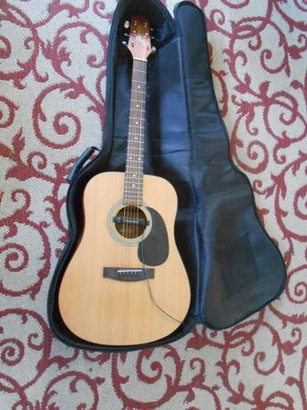 Photo Acoustic Guitar with Pick up and Gig Case - $125