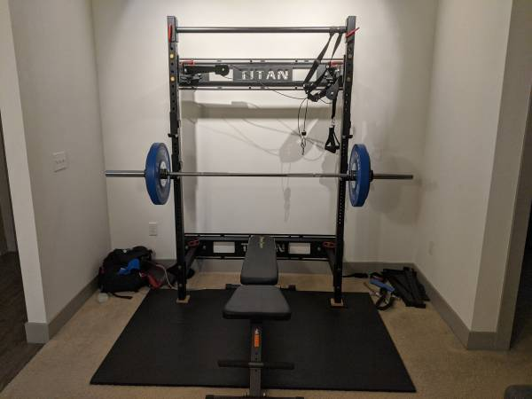 Photo Olympic weight set folding squat rack, barbell, competition bumpers - $1200 (College Station)