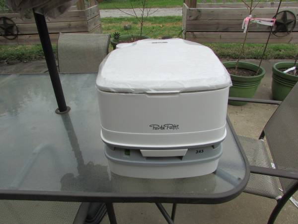 Photo RV or Cing Portable Potty UNUSED - $75 (Madisonville)