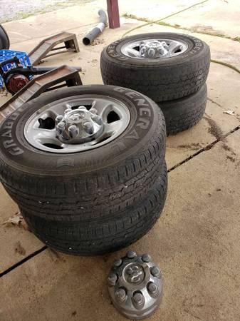 Photo Set of 8 Lug Dodge Ram rims and tires - $250 (Centerville)
