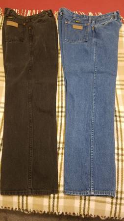 Photo Wrangler Jeans 1 black pair 1blue pair size 36 30 - $20 (Bryan)