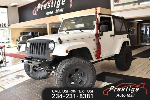 Photo 2012 Jeep Wrangler Sahara - $20,492 (Includes 6 month warranty)