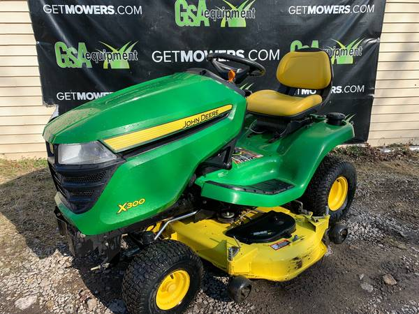 Photo 48IN JOHN DEERE X300 LAWN TRACTOR ONLY 222 HOURS CLEAN $54 A MONTH - $2,200 (Barberton)