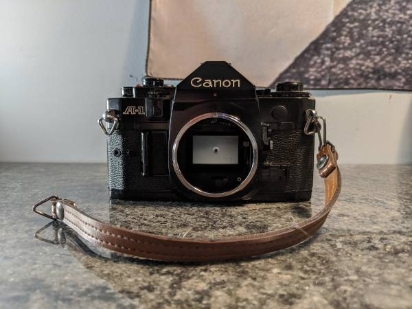 Photo Canon A-1 35mm SLR Film Camera with manual (Body Only) Stuck Release M - $50 (Galloway)
