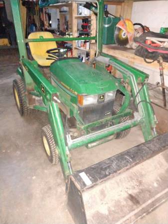 Photo John Deere 445 with 40 front loader - $4250 (Delaware)